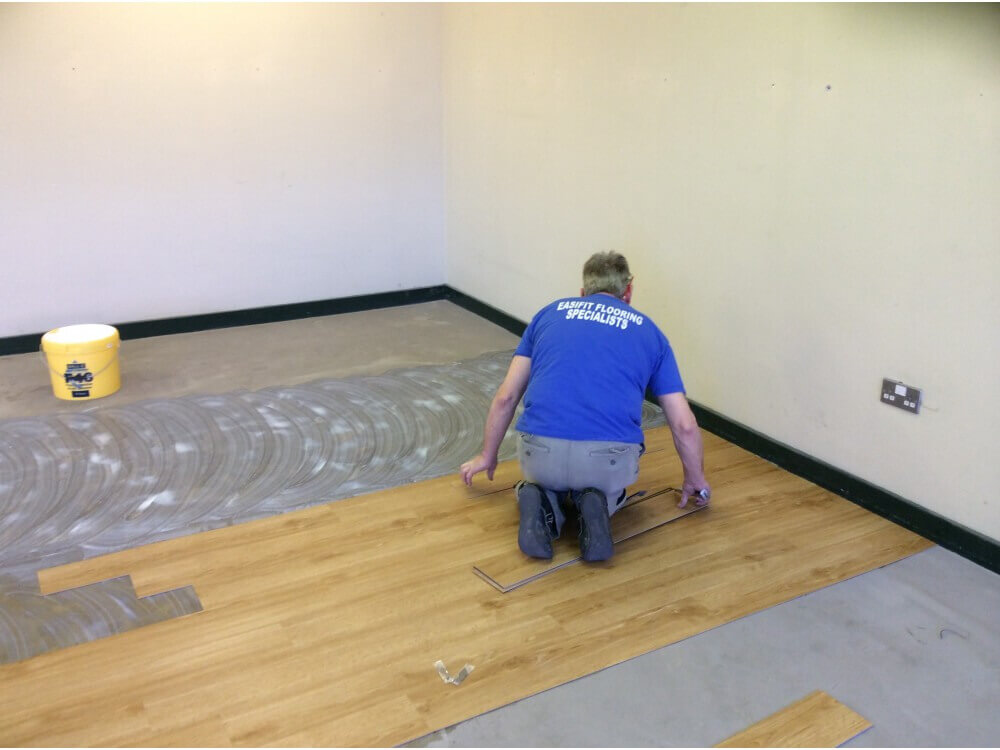Library Woodplank vinyl being installed 2