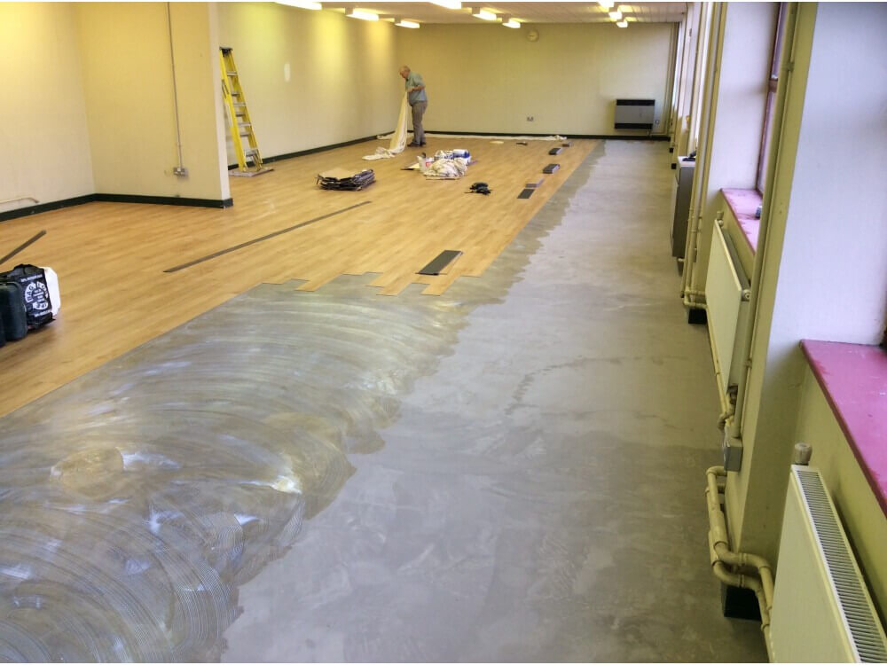Library Woodplank vinyl being installed