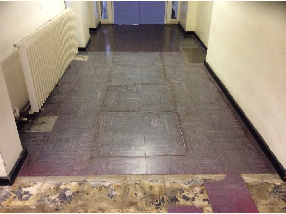 Uplifting asbestos containing tiles from sub-floor